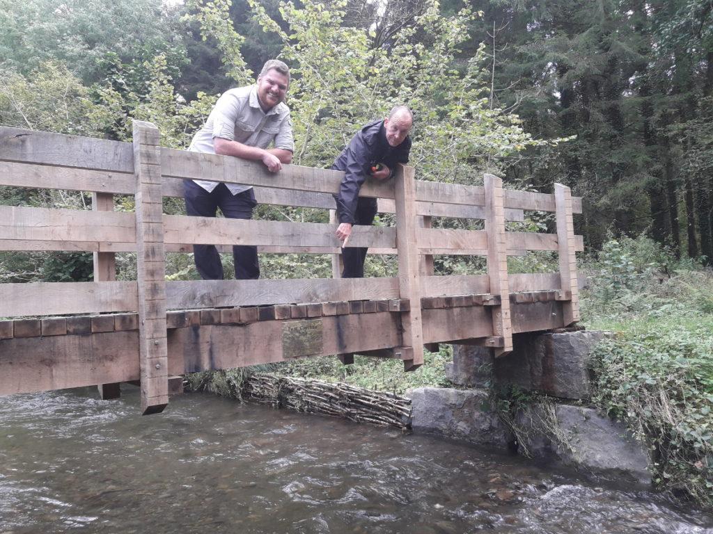 NRW install the plaque on the footbridge